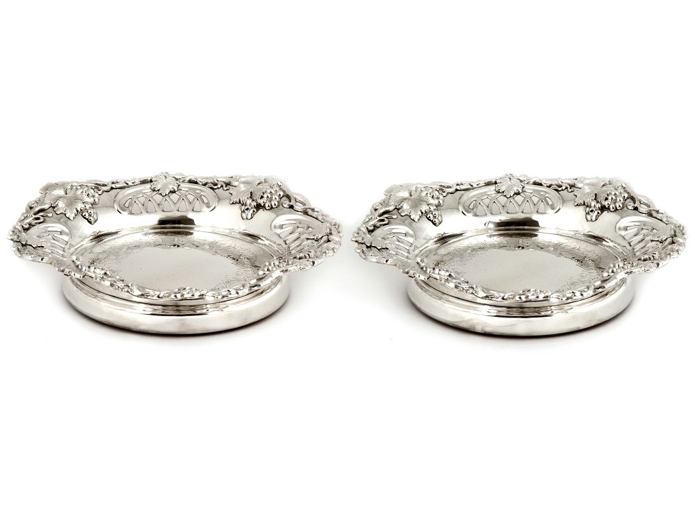 pair of large silver plated coasters with grape vine decoration