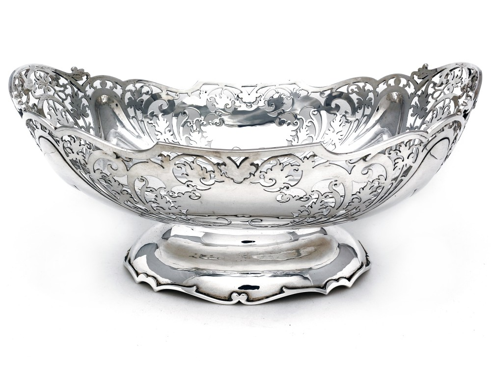 oval boat shaped silver bowl pierced with leaves and scrolls