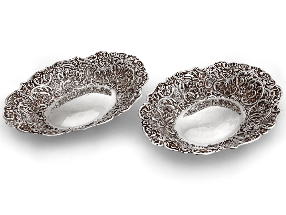 pair of decorative oval antique silver bon bon dishes