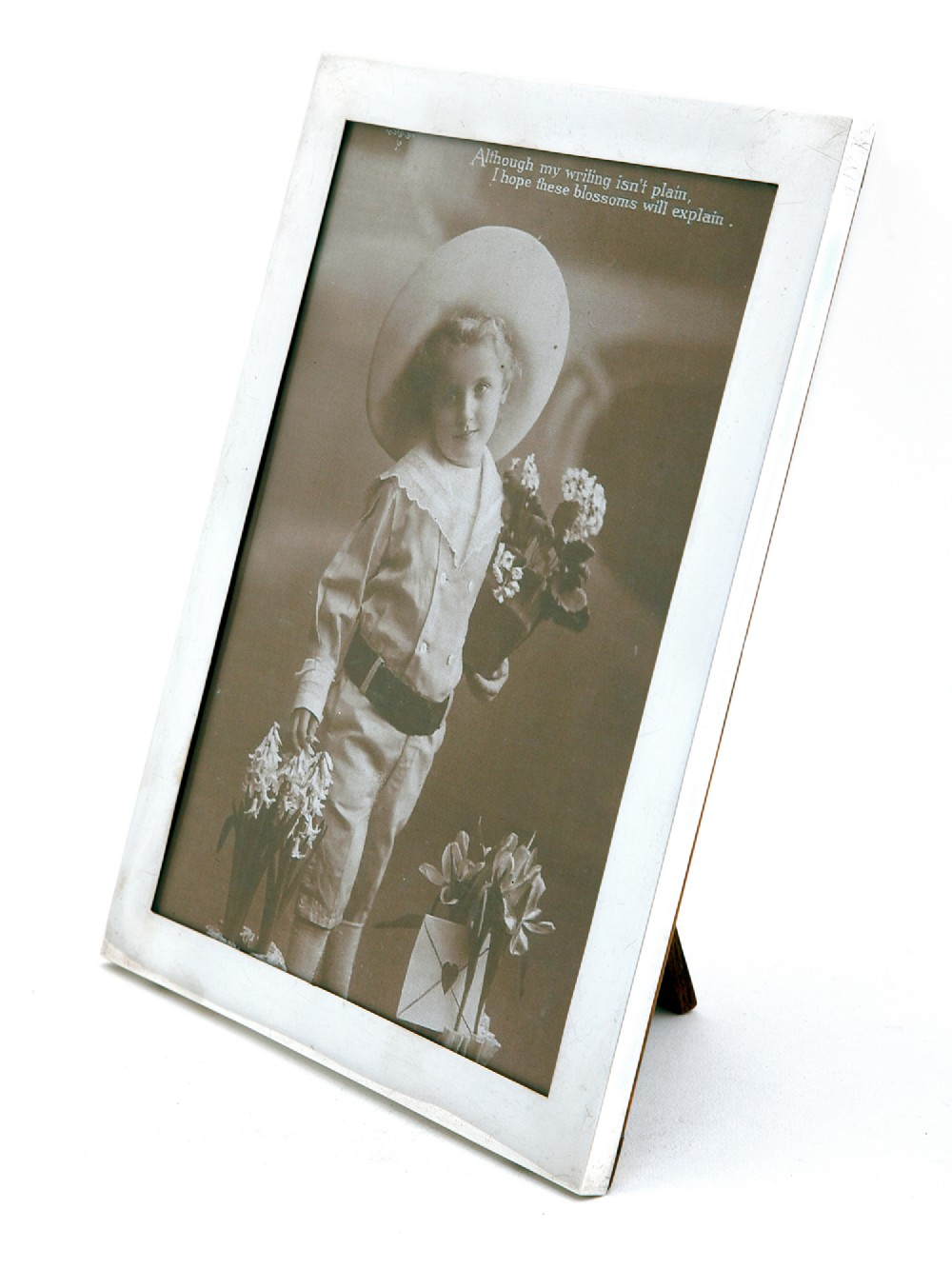 plain silver antique photo or picture frame with an oak easel stand back