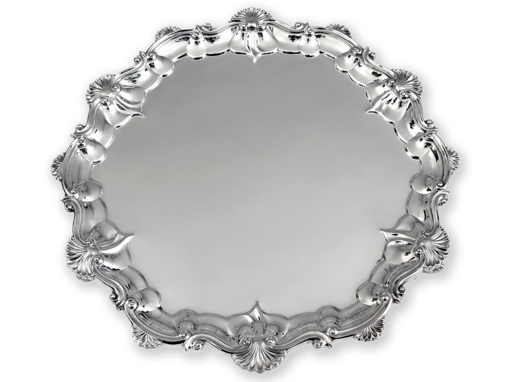 large victorian silver salver with an applied shell and scroll border