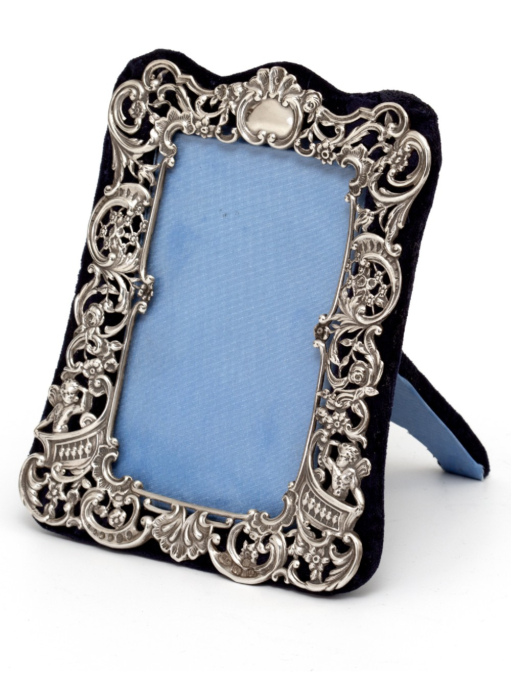 small william comyns silver photo or picture frame decorated with cherubs scrolls and flowers