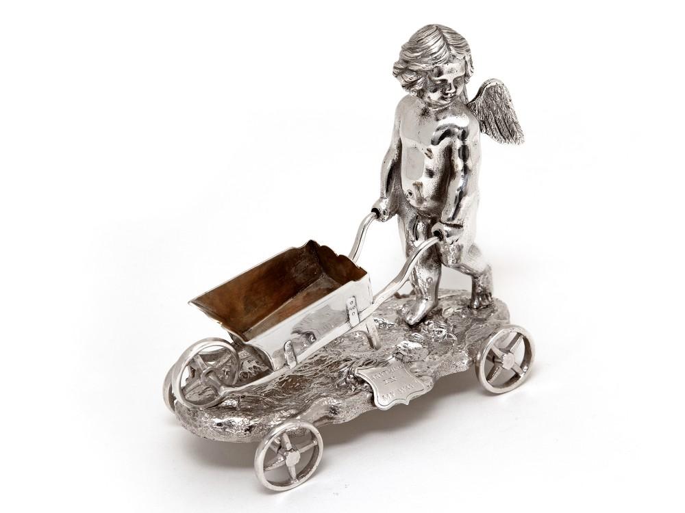 victorian silver plated winged cherub pushing a wheelbarrow salt