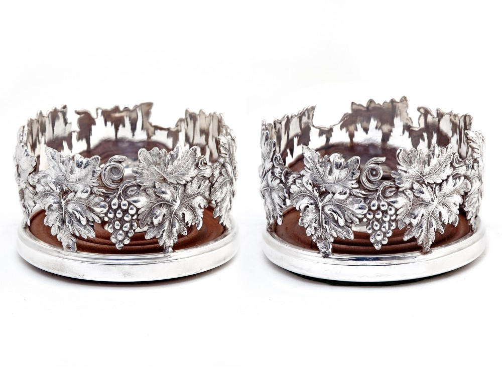 pair of good quality silver plated cast open work grape and vine coasters