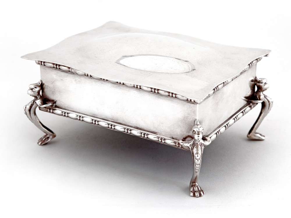silver plated jewellery box with plain domed lid and gargoyle feet