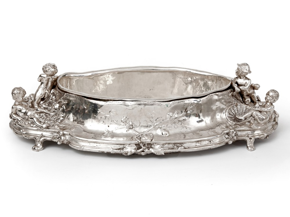 antique silver plated jardiniere with scenes of cherubs picking grapes and in a barley field