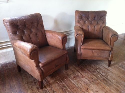 Merveilleux A Pair Of Late 19th Century Brown Leather Button Back Library Chairs