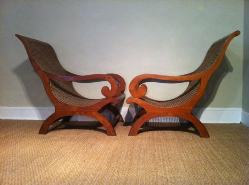 a matched pair of colonial teak and caned plantation chairs c 1920 - photo angle #2