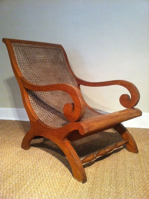 A Matched Pair Of Colonial Teak And Caned Plantation