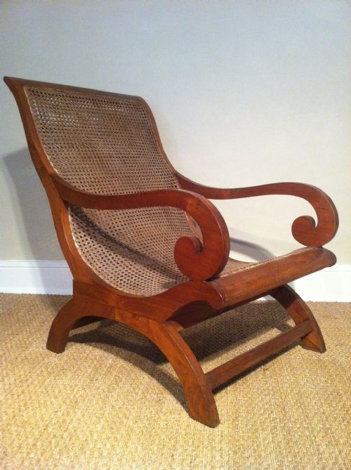 a matched pair of colonial teak and caned plantation chairs c 1920 - photo angle #4