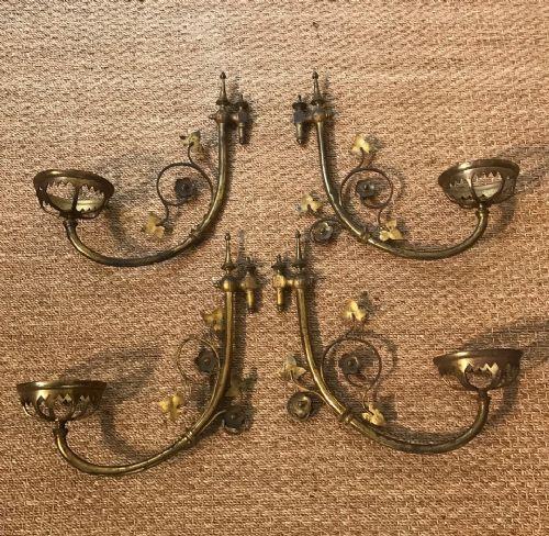 a set of four gothic reform gilt brass wall light brackets circa 1870