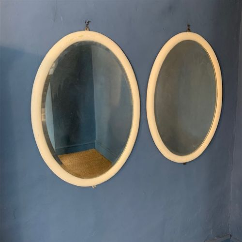 a large pair of edwardian white painted oval mirrors circa 1910