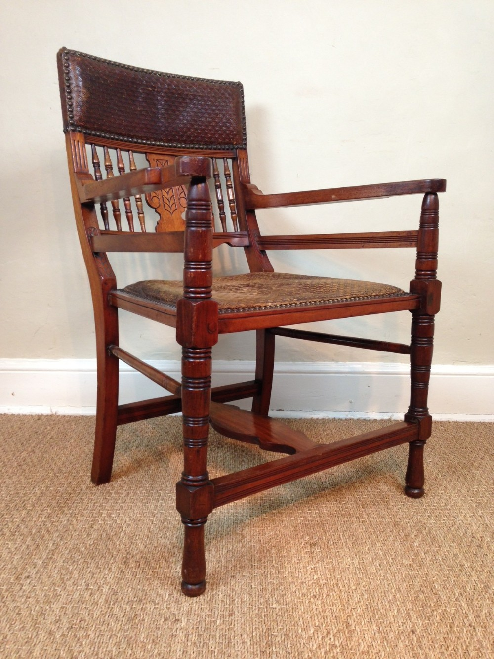 an aesthetic movement walnut and leather desk chair c 1880