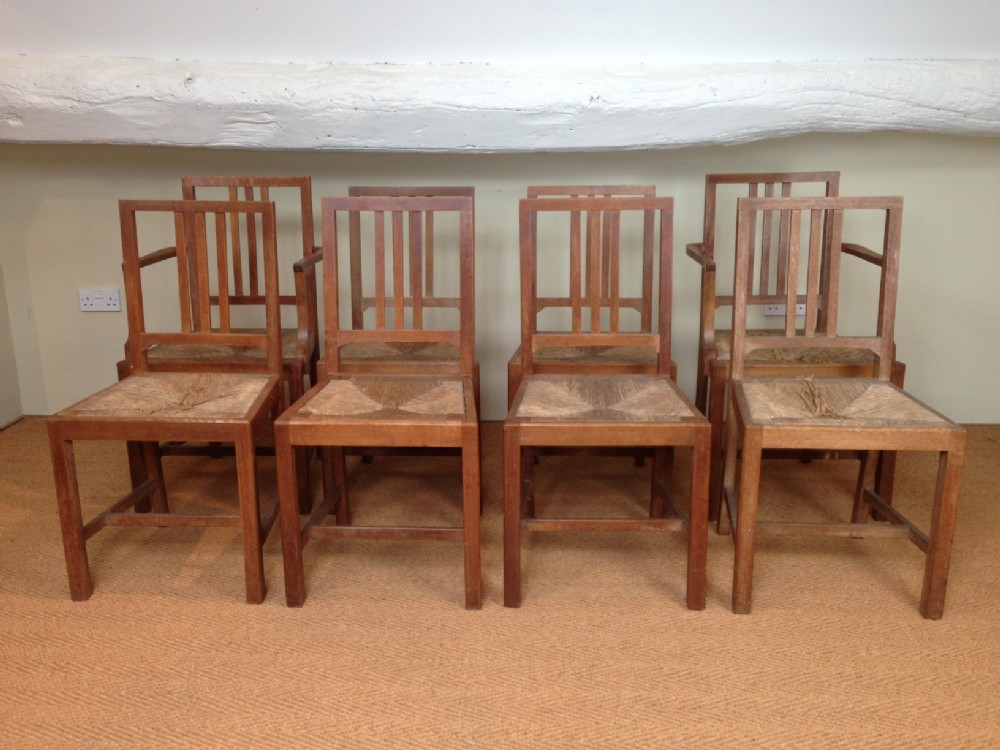 A Set Of 8 Heals Limed Oak Dining Chairs C 1930