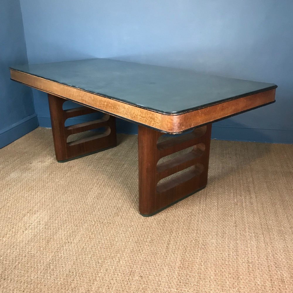 an art deco birds eye maple and rosewood and silvered glass topped table circa 1930