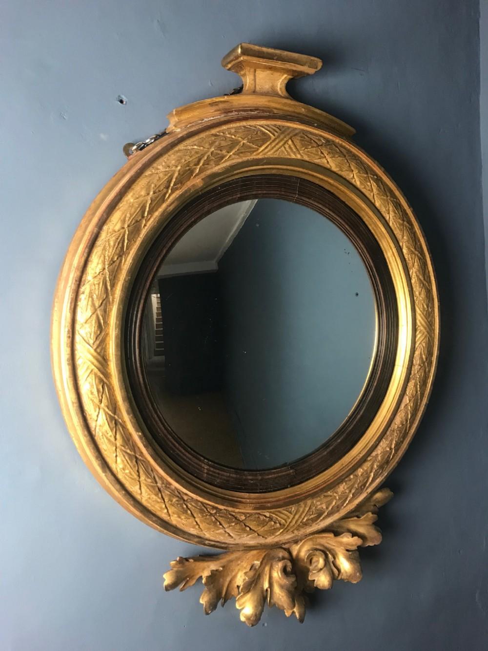 an unusual george iv convex mirror circa 1825