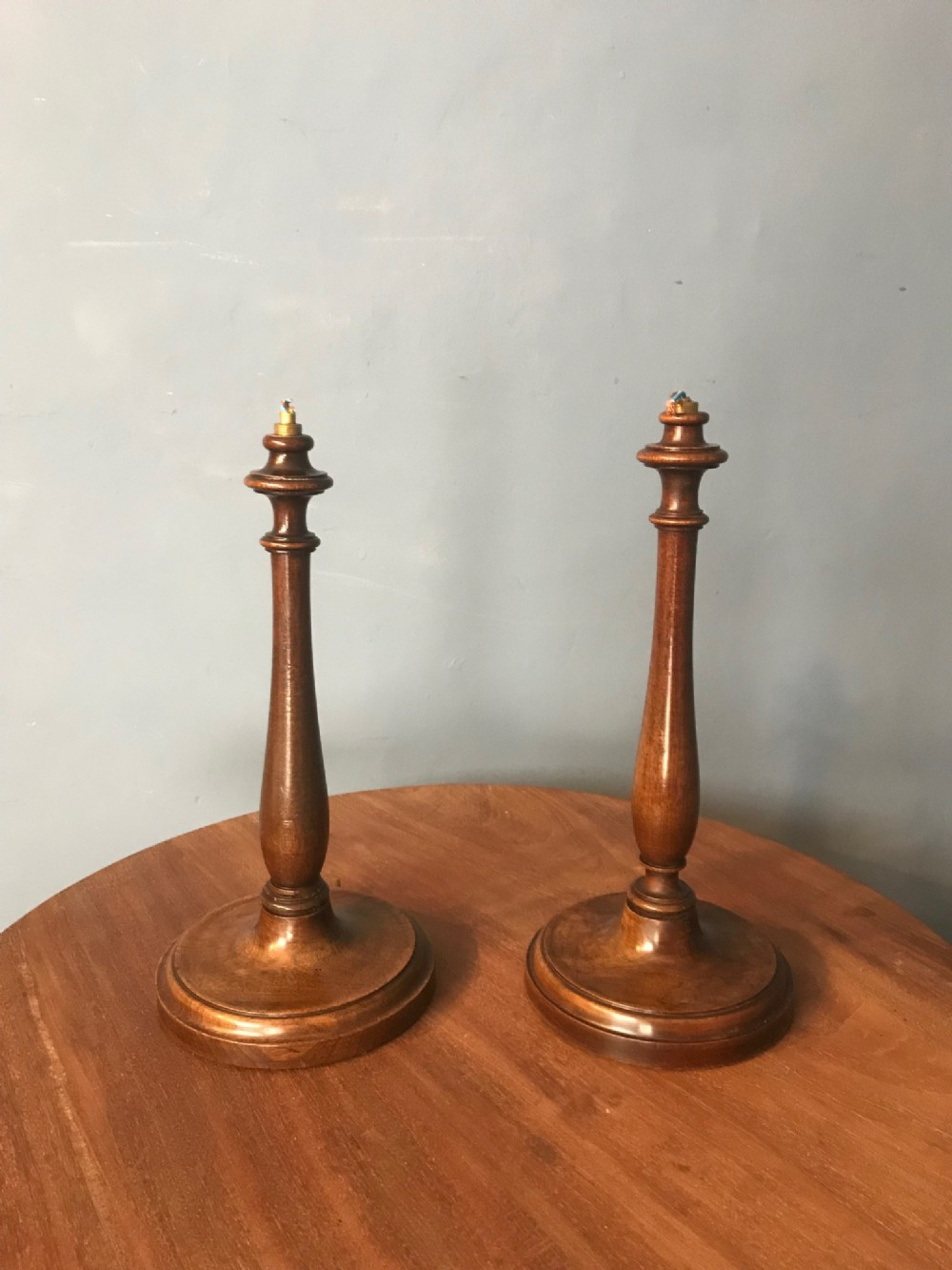 a pair of edwardian walnut table lamps circa 1910
