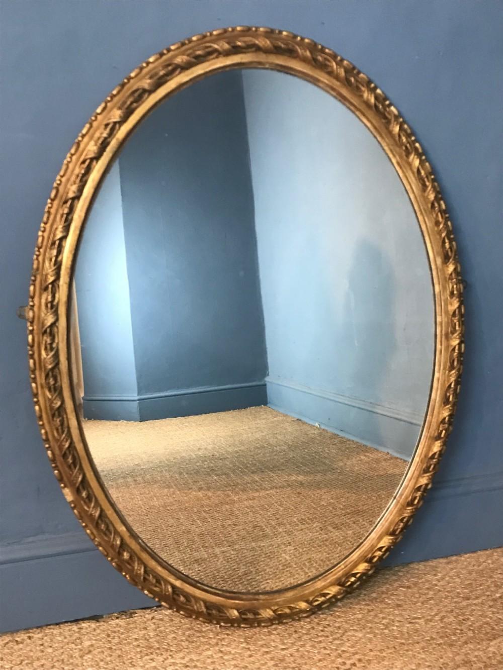 a large mid 19th c english gilt oval mirror circa 1860
