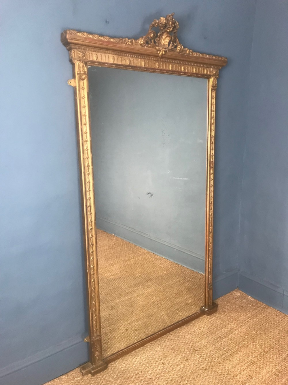 a large victorian gilt pier mirror circa 1880 with the original gilding and silver mercury plate