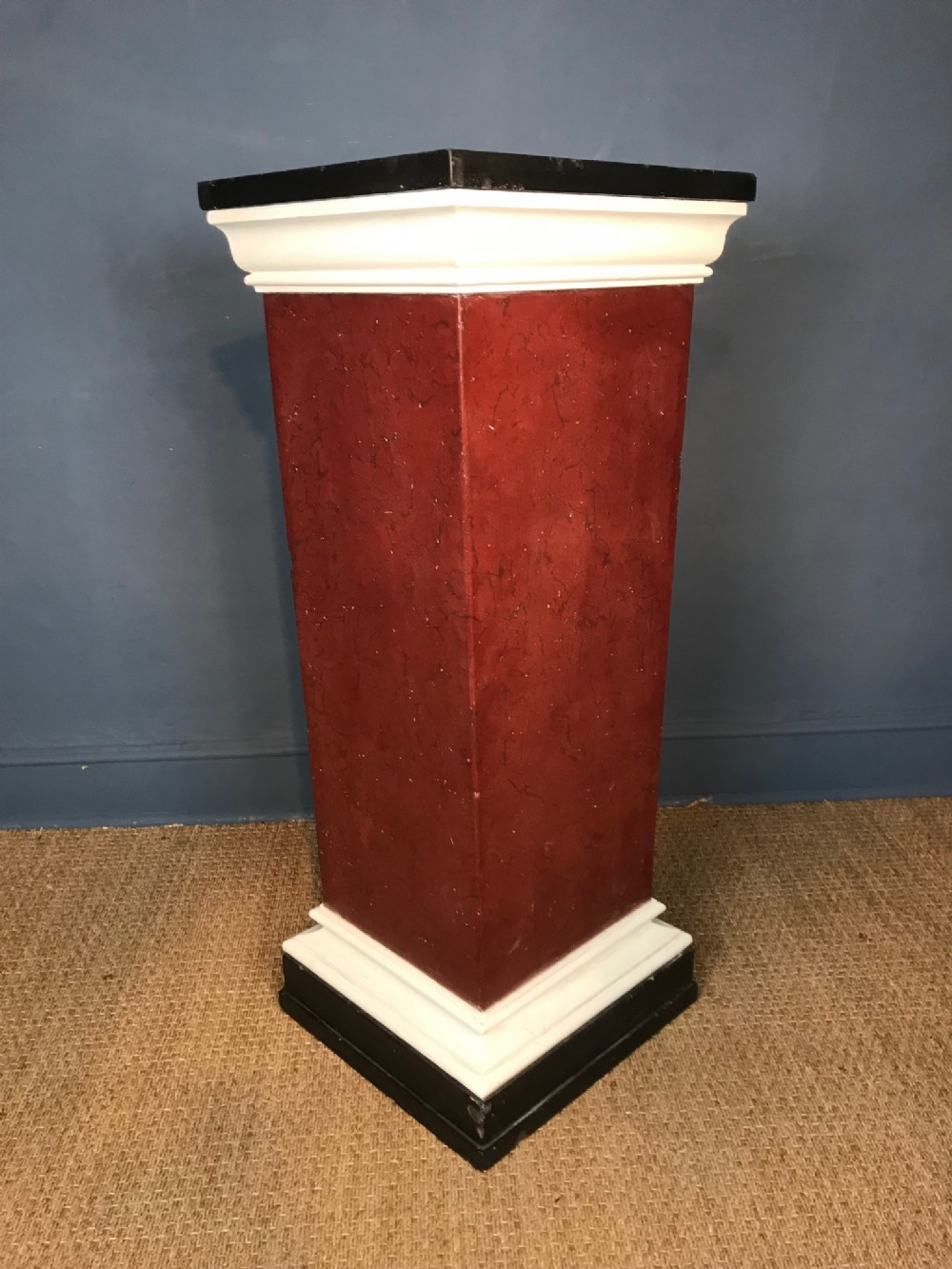 a late regency simulated porphyry black marble and plaster pedestal circa 1830