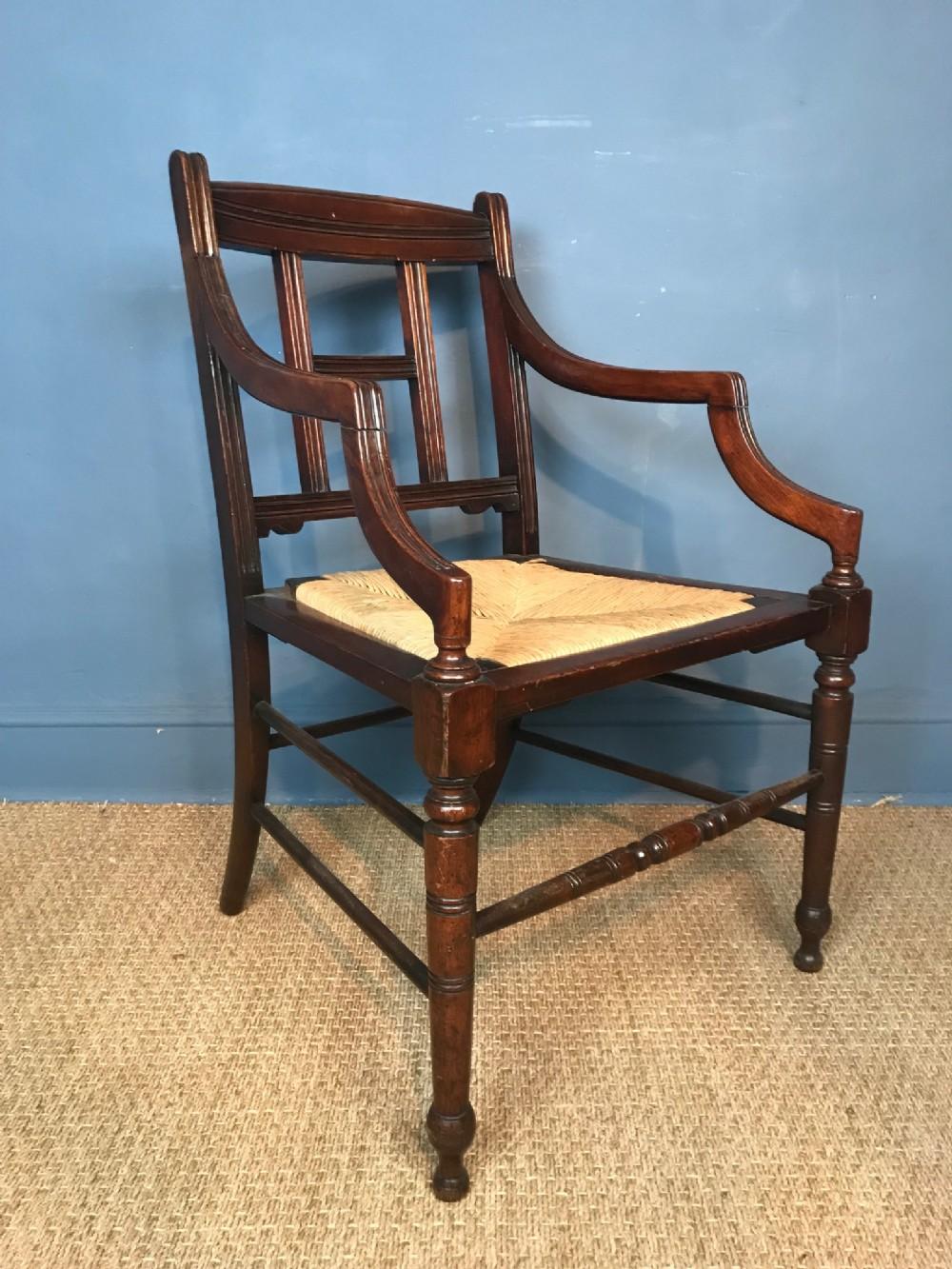 an aesthetic movement walnut armchair circa 1890