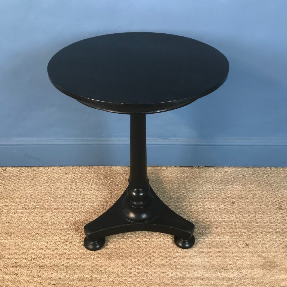 a william iv ebonised mahogany lamp table circa 1835