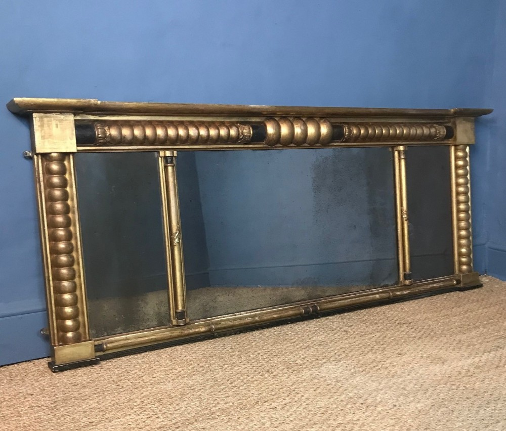 a large regency triple plate gilt over mantel mirror circa 1820
