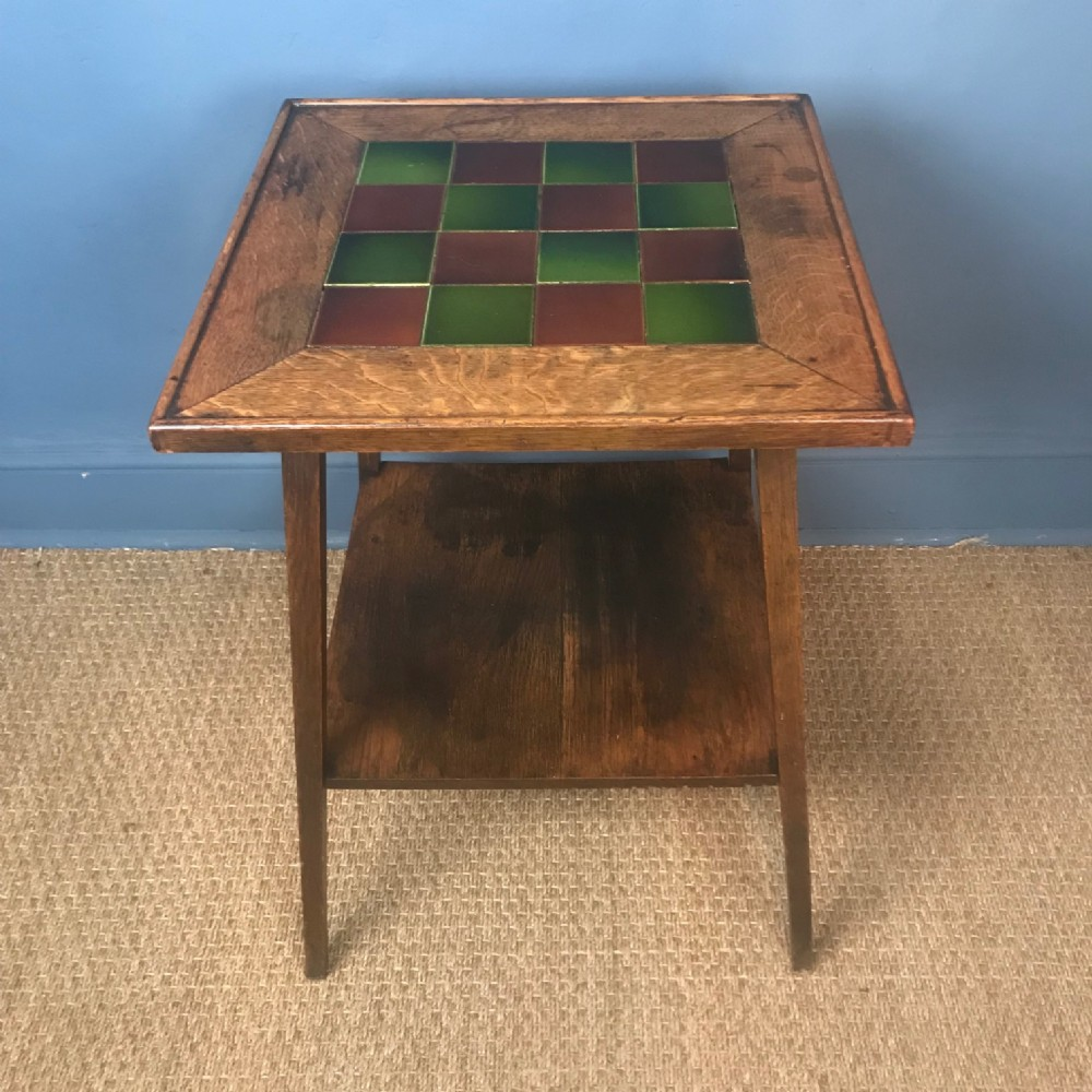 an arts and crafts oak tile top table circa 1910