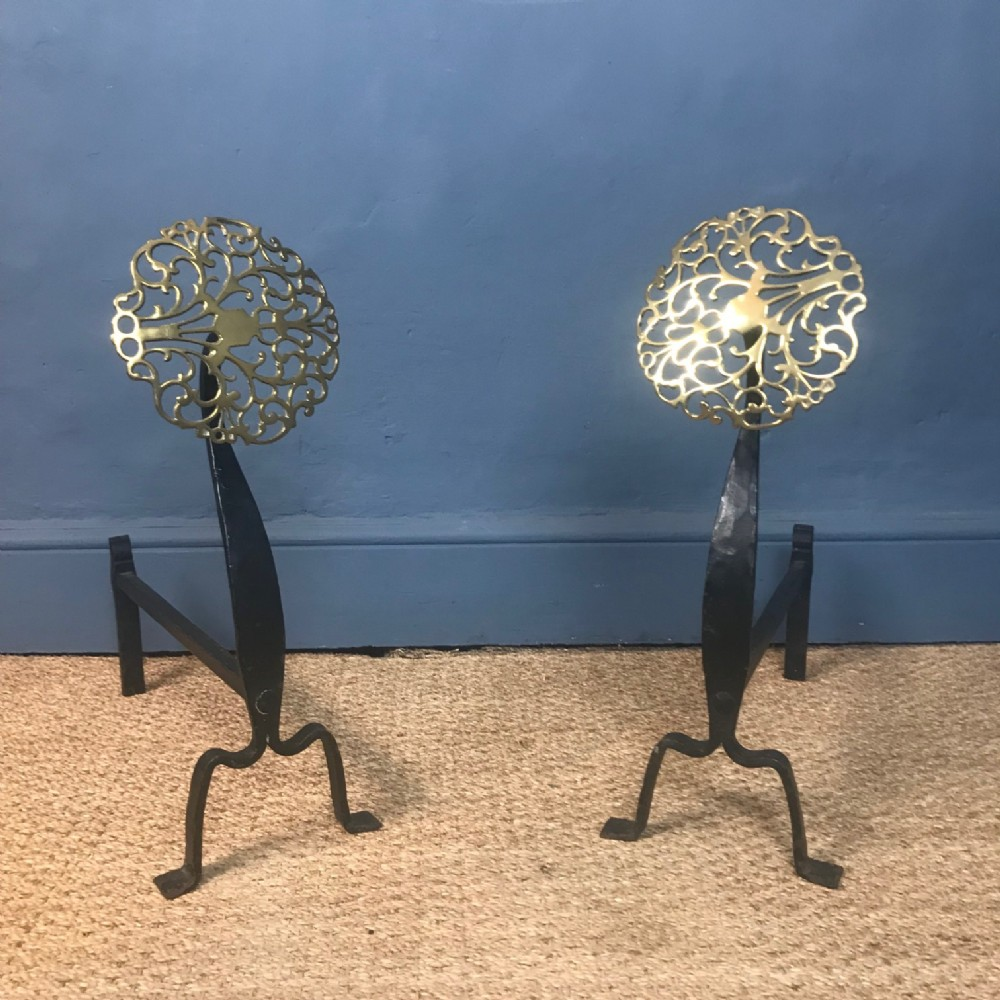 a pair of arts and crafts brass and wrought iron fire dogs circa 1910