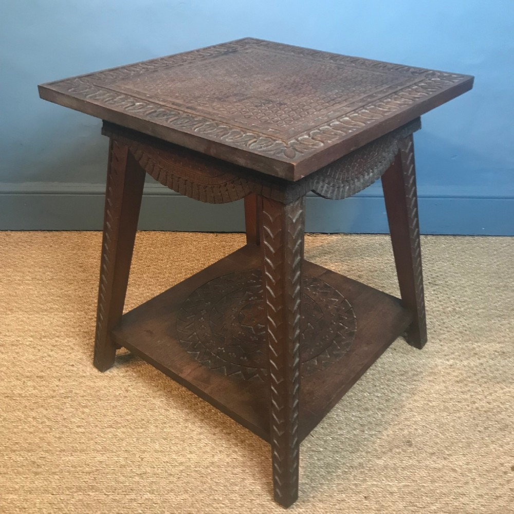 an anglo indian teak table chip carved in arts and crafts style circa 1900