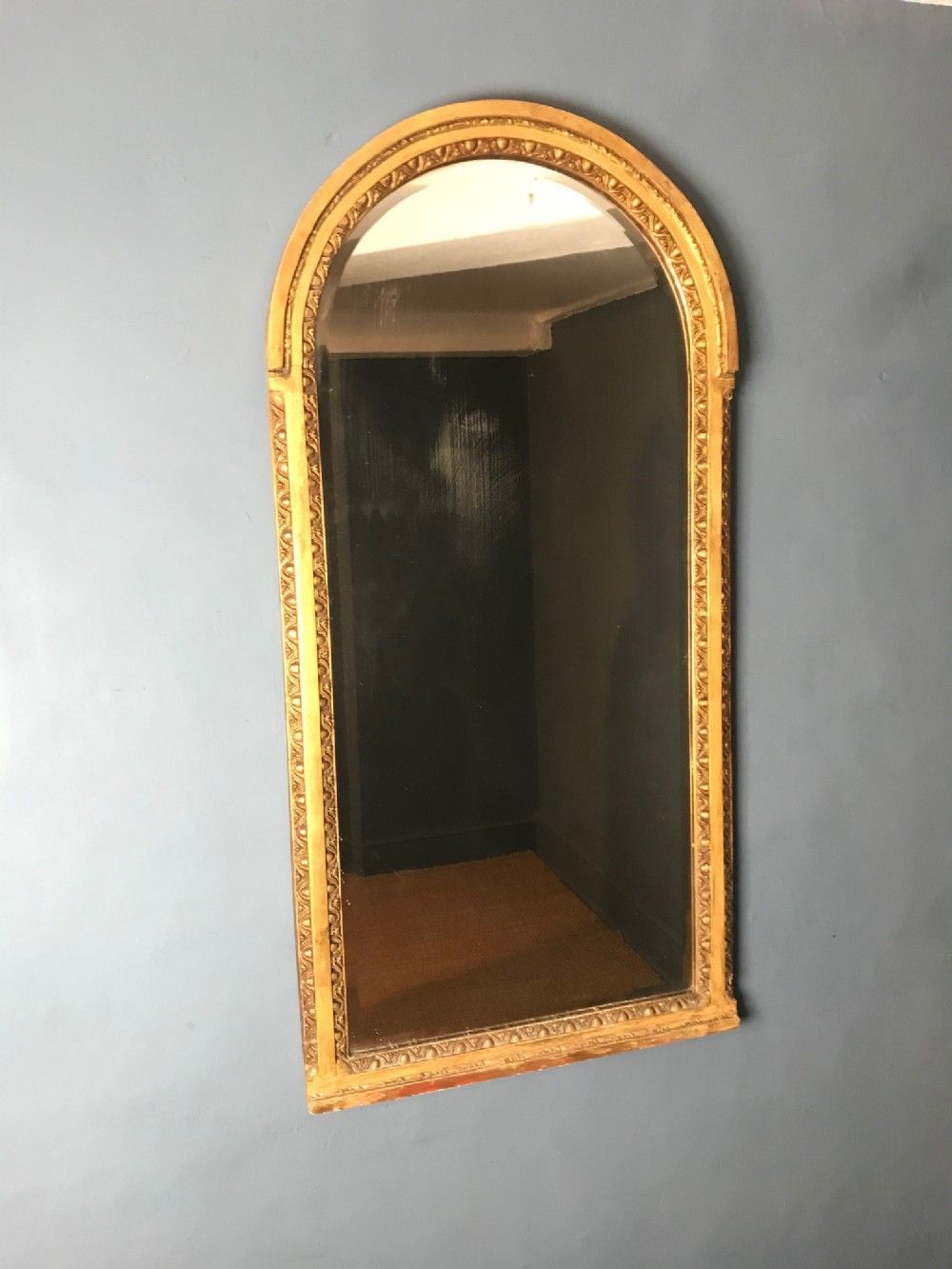 a mid victorian arched gilt mirror circa 1870