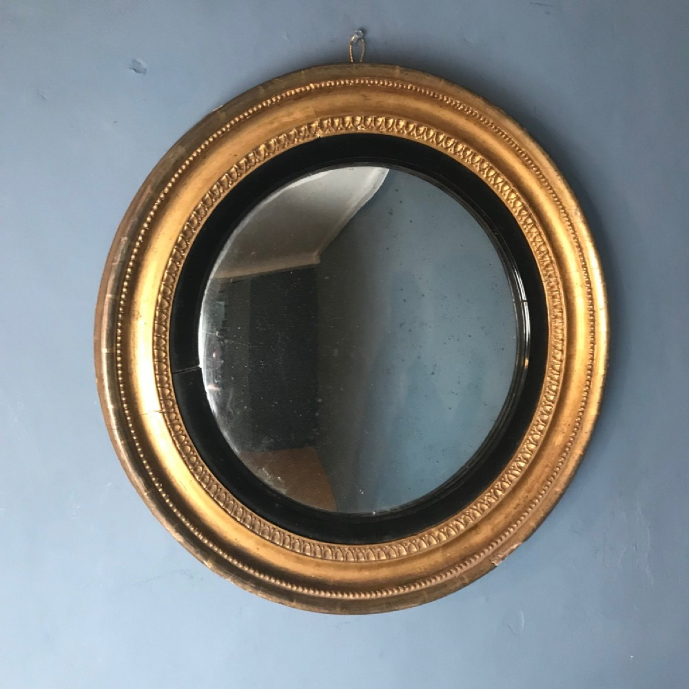 a small regency gilt convex mirror circa 1820