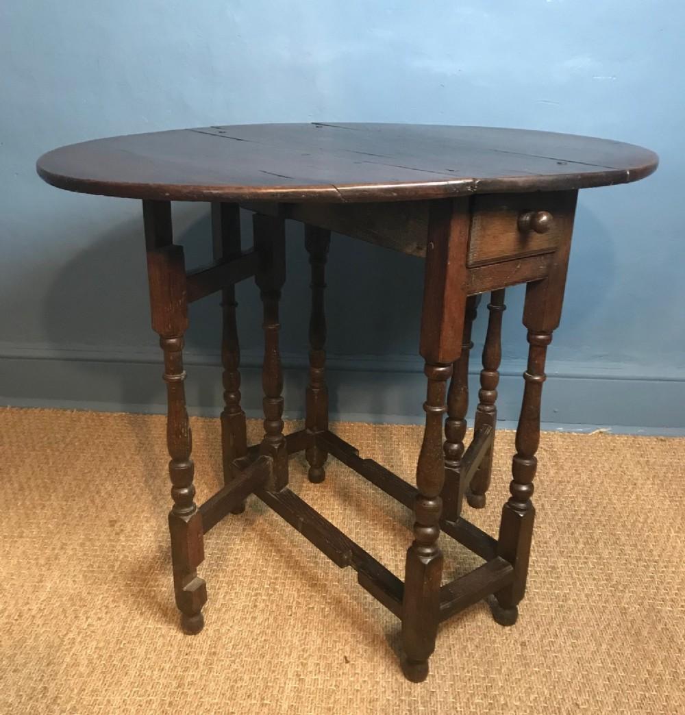 a queen anne oak small gate leg table circa 1710