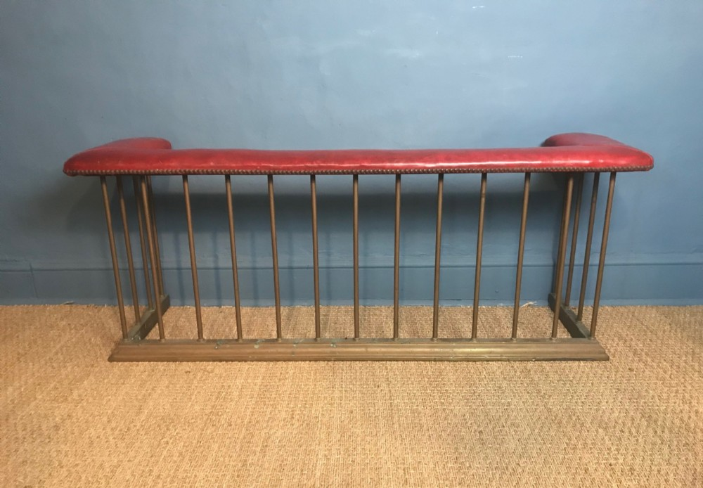 a late victorian brass club fender c 1900 with original red leather top