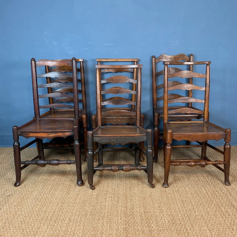 a harlequin set of 6 late 18th cheshire cottage ladder back chairs