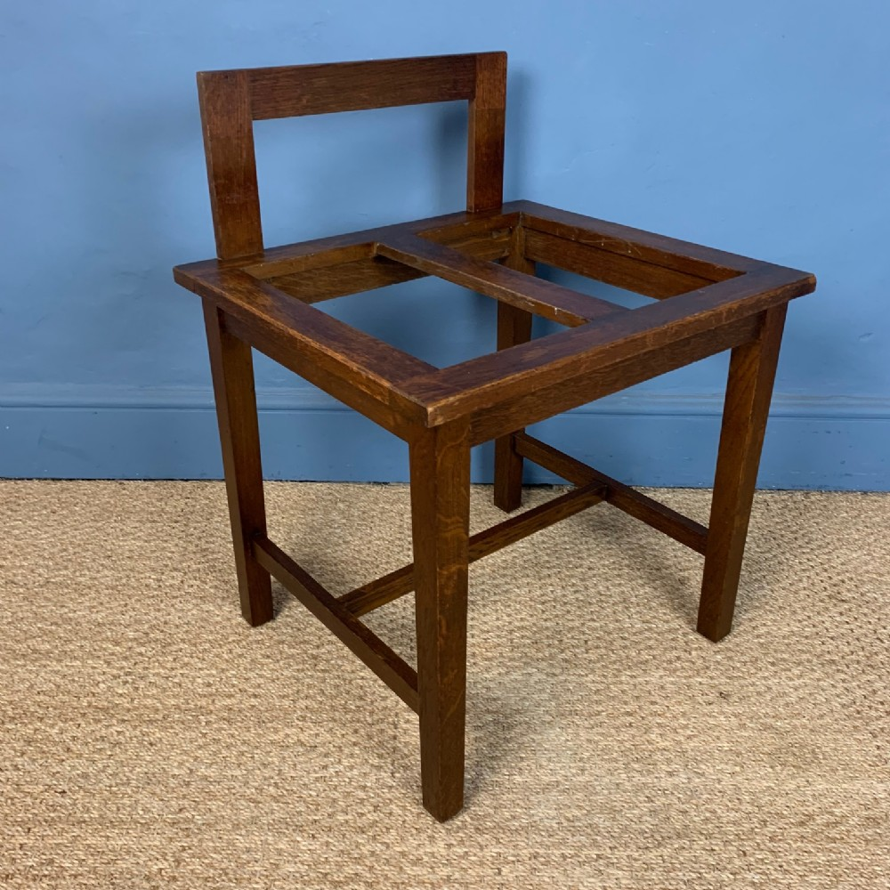 an edwardian oak luggage rack circa 1910