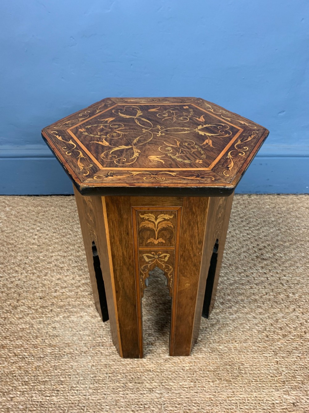 a small arts and crafts rosewood and marquetry hexagonal table in damascus style circa 1900