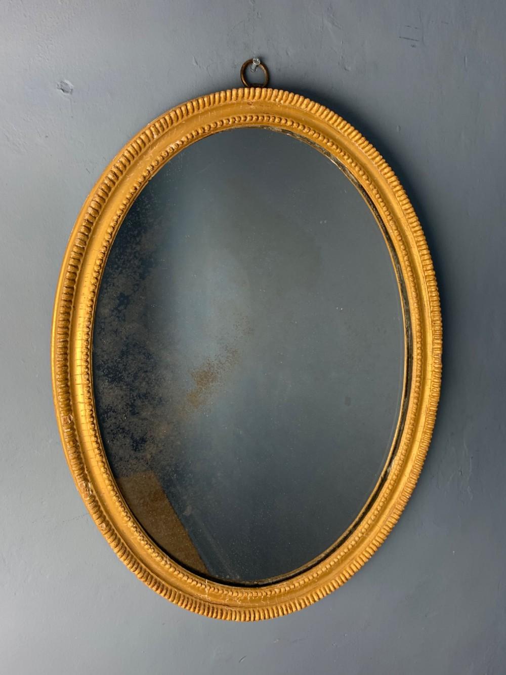 a small regency gilt oval mirror circa 1810