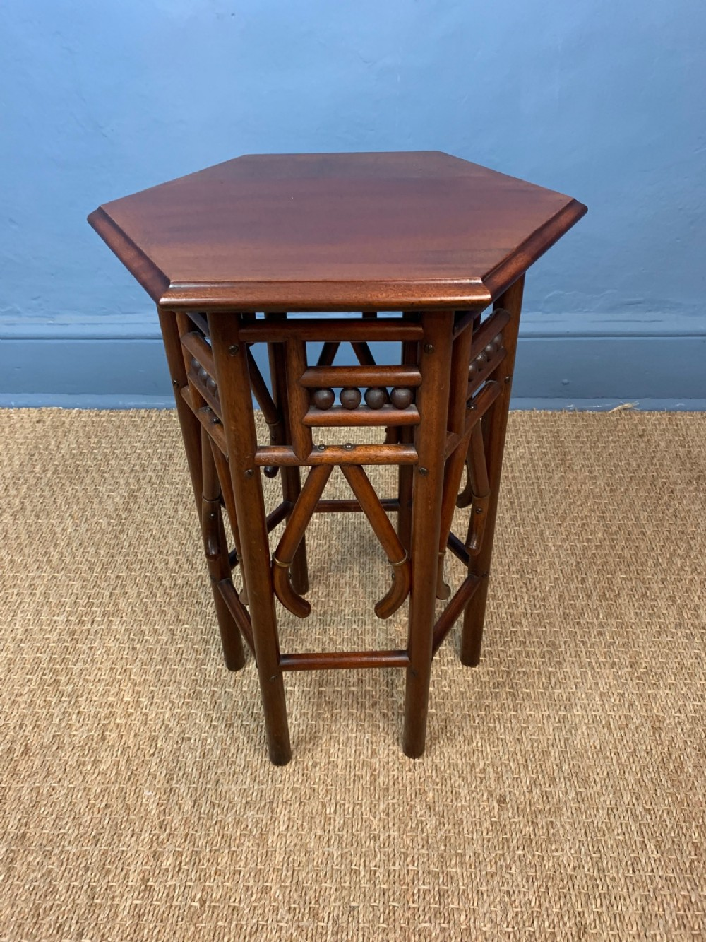 a liberty mahogany and brass banded small hexagonal table c 1900