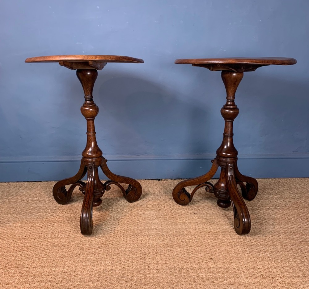 a pair of mid 19th c oak and elm tripod tables circa 1840 in the style of anthony salvin
