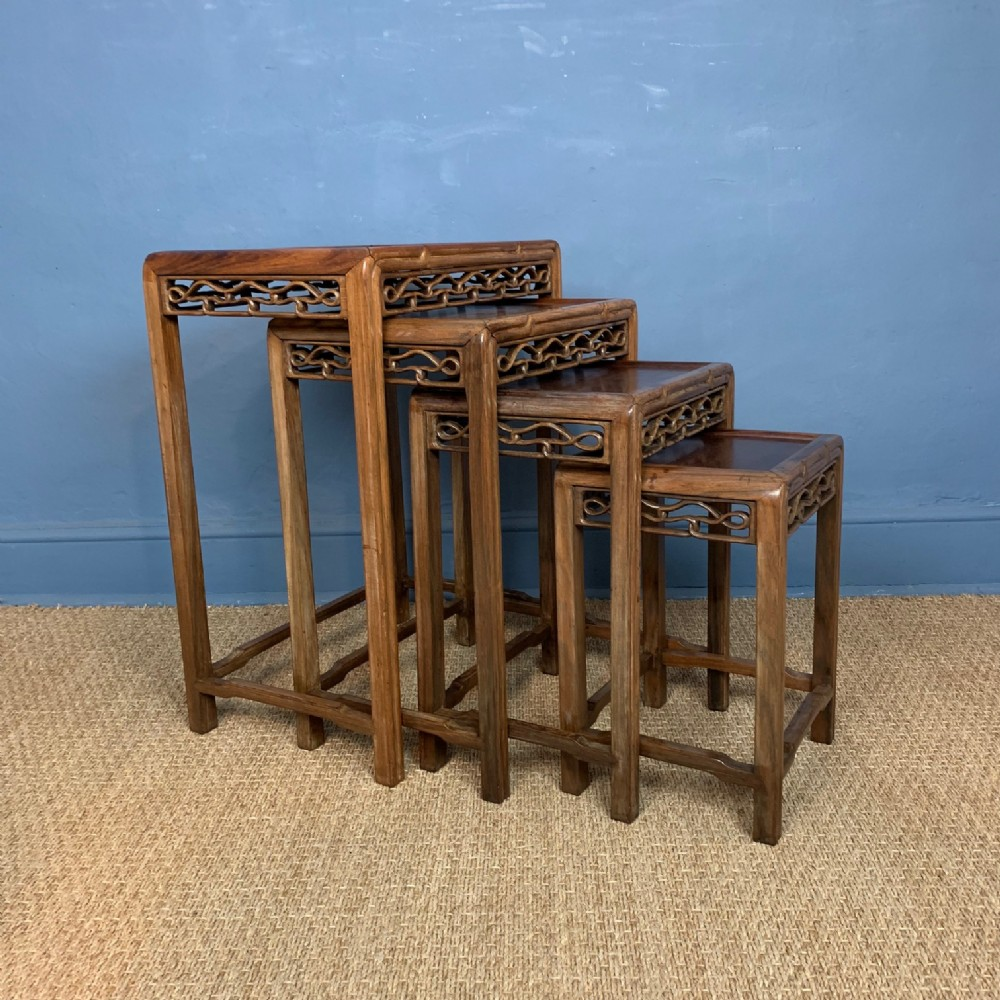 a nest of 4 chinese carved padoukwood tables circa 1890