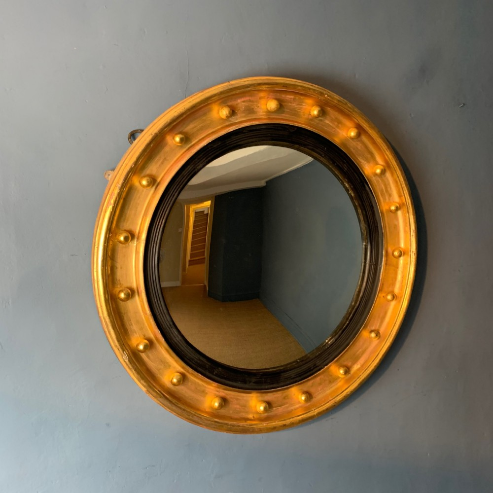 a large mid 19th c gilt convex mirror circa 1860