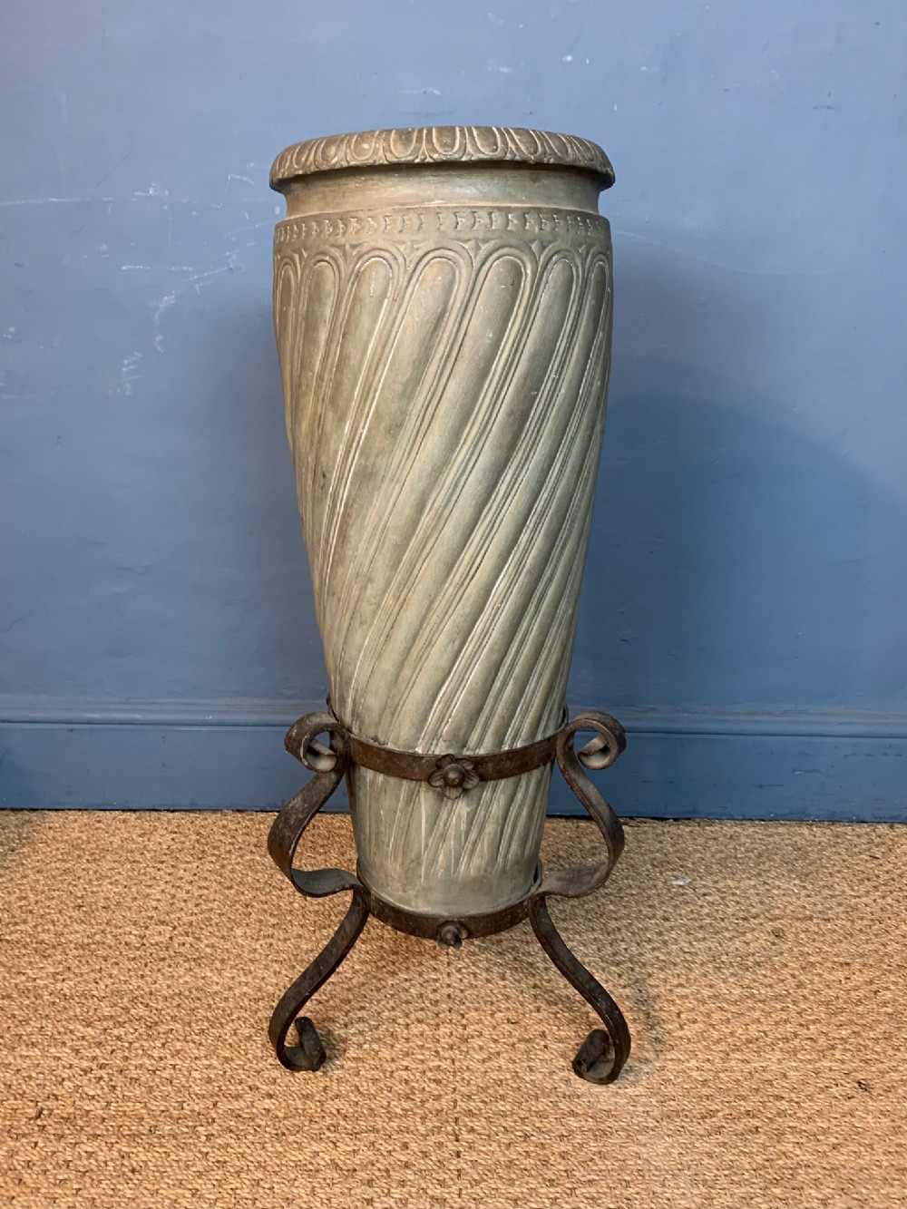 a late 19th c green terracotta umbrella stand circa 1890