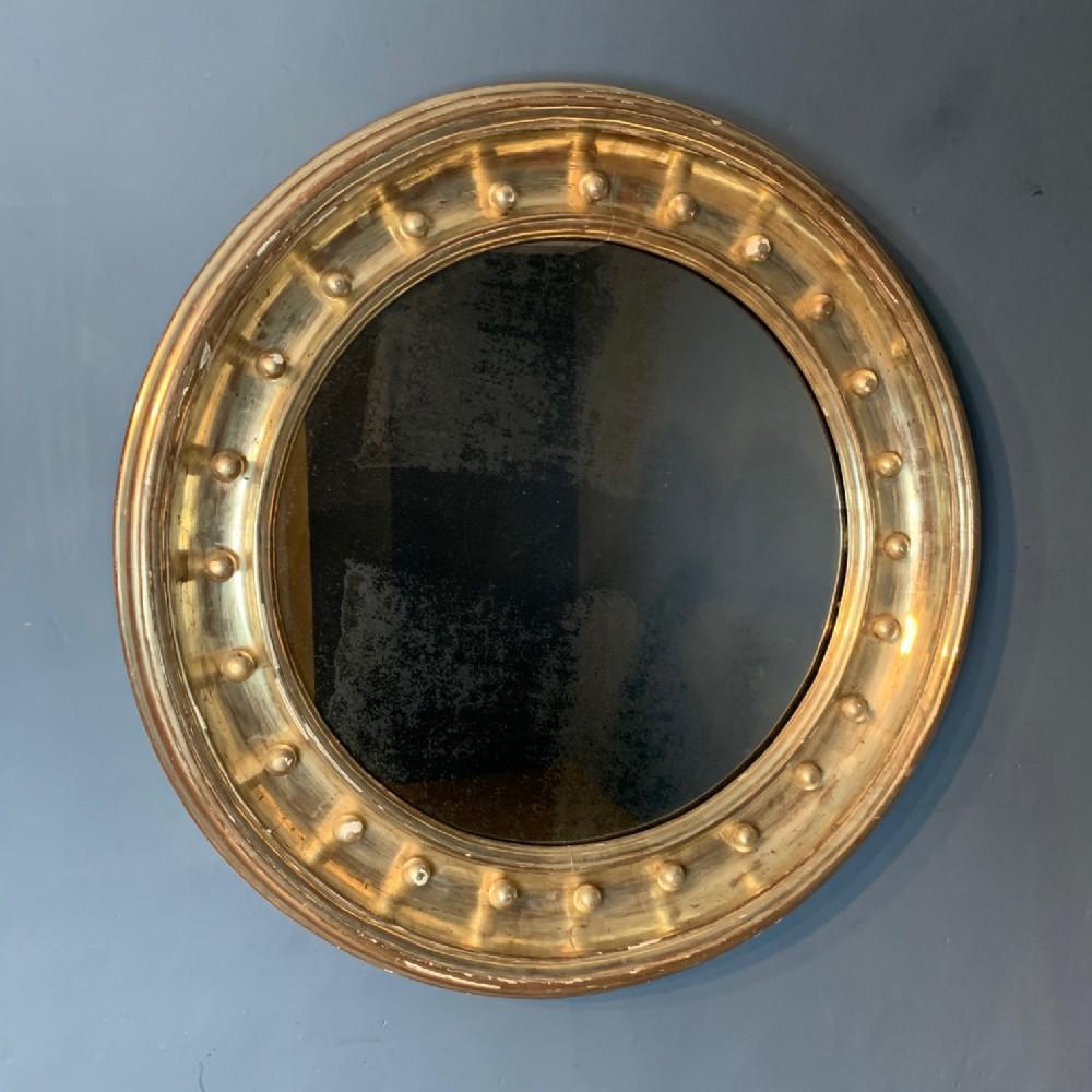a very large regency style silver gilt circular mirror circa 1820