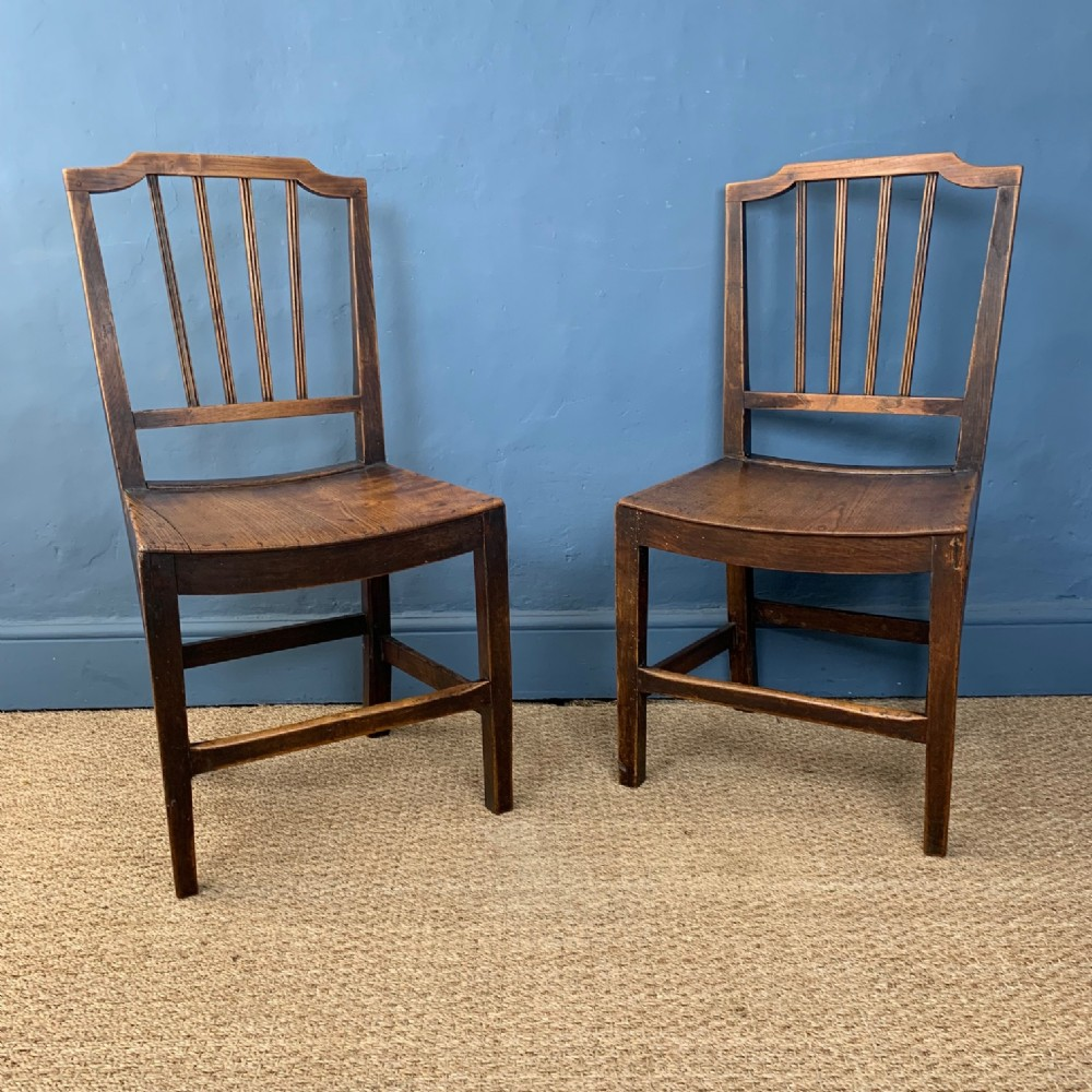 a pair of late georgian country sheraton stick back chairs circa 1820