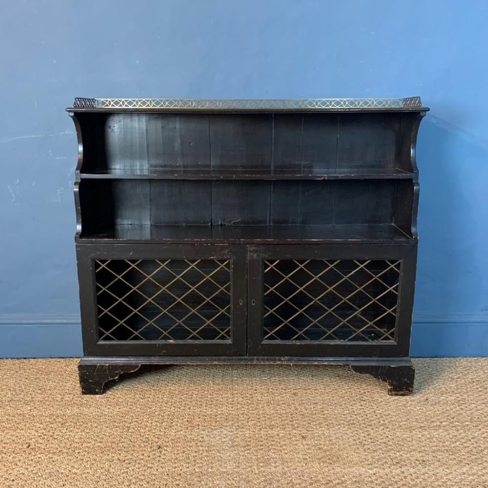a regency painted pine bookcase circa 1820