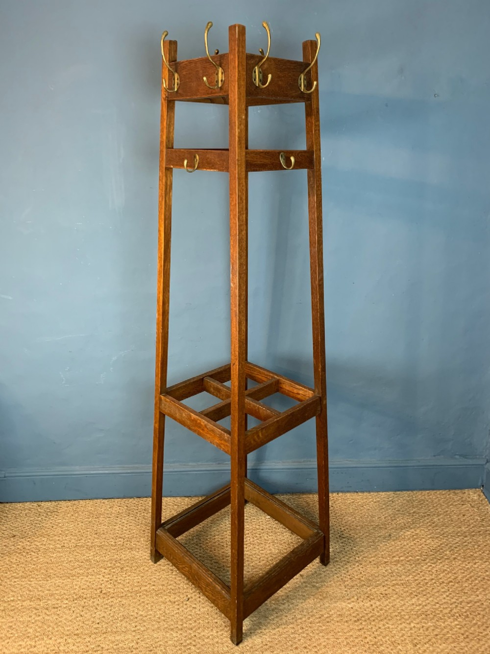 an edwardian oak and brass hall stand circa 1910