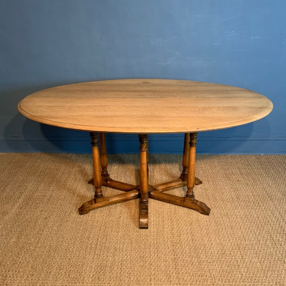 an arts and crafts oak oval centre table circa 1900