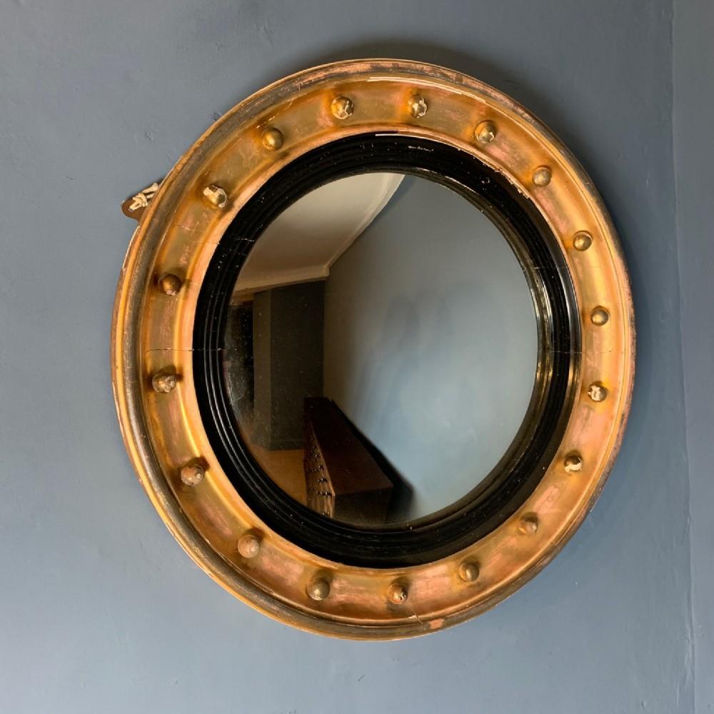 a regency gilt convex mirror circa 1830