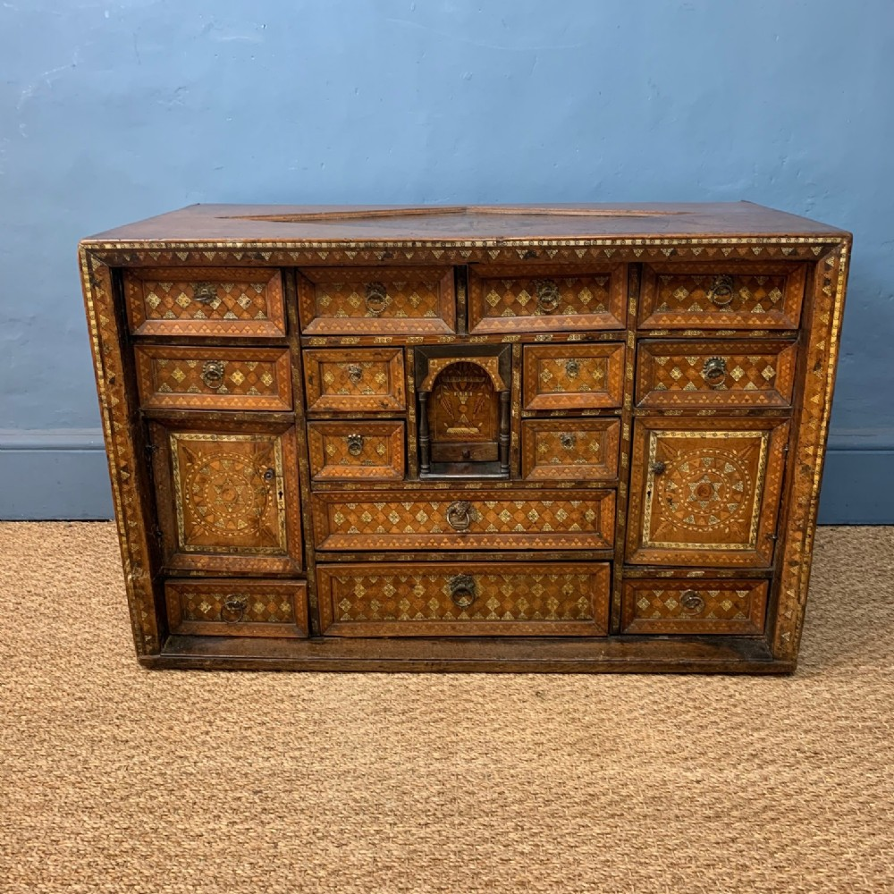 a rare early 17th century iberian walnut and bone inlaid table cabinet possibly spanish colonial dated 1613